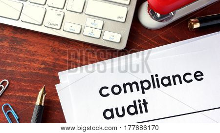 Compliance audit on a document and other papers.