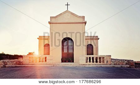 View of the small ancient chapel in the rays of sunset, Chapel of Immaculate Conception in Malta