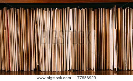 Vintage Keeping Retro Records On Wooden Shelves, Old Retro Business Background.