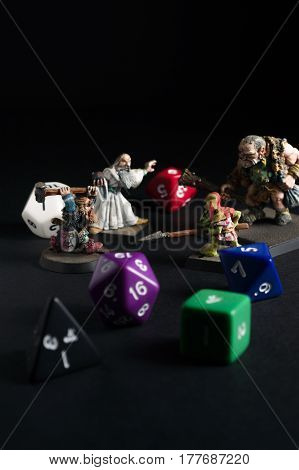 Wrexham UK - March 21 2017: Dungeons and Dragons dice and hand painted lead figures produced by Citadel Miniatures in 1983 as accessories to the game created by by Gary Gygax and Dave Arneson in 1974