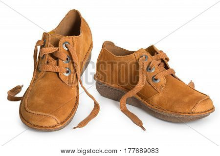 Pair of fashion stylish chamois leather shoes for women isolated on a white background close up.