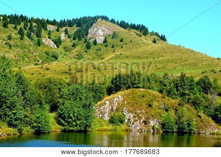 Landscape in Apuseni Mountains, Transylvania. The Apuseni Mountains is a mountain range in Transylvania, Romania, which belongs to the Western Romanian Carpathians, also called Occidentali in Romanian.