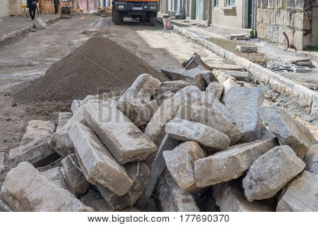 image of road works on cobblestone laying