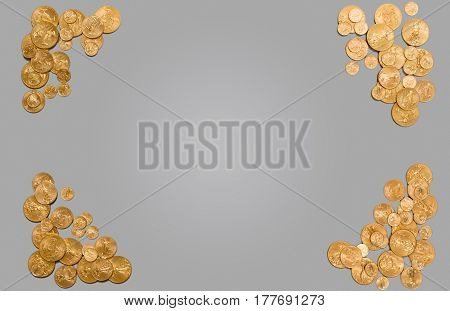 Solid gold USA coins arranged around edge of plain grey background. Suitable for header image or concept for wealth or financial management