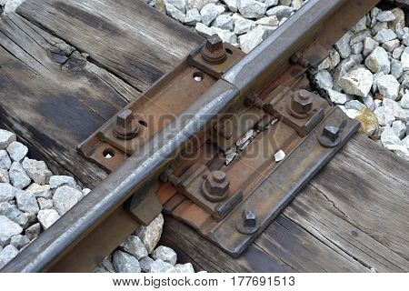 close-up part of a small vintage railroad tracks železnikće