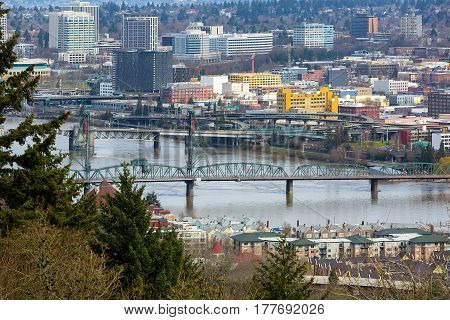 Hawthorne Bridge by waterfront condominiums over Willamette River in downtown Portland Oregon