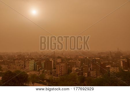 Khamsin in Cairo The Sun view in Cairo during sandstorm caused by Khamsin in April, 2015