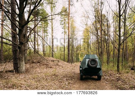 Russian Armoured Soviet Scout Car BA-64 Of World War II In Spring Forest. Vehicle Of Red Army