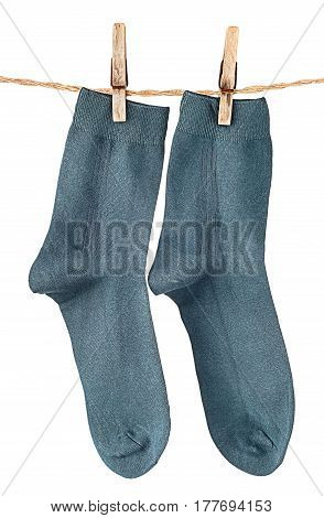 Dark blue socks on rope with clothespins isolated on white background