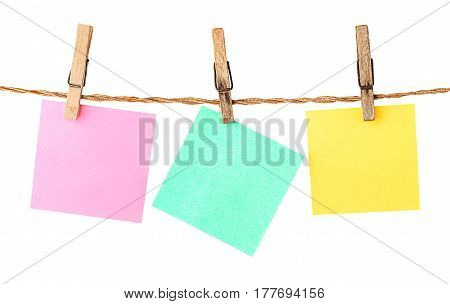 Multicolored paper stickers on clothespins isolated on white background