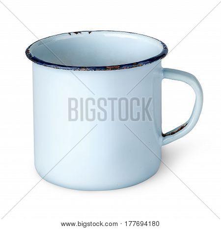 Old worn enameled mug rotated isolated on white background