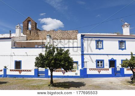 Houses In Front Of The Castle Walls And Church  The Village Of Redondo, Alentejo Region, Portugal