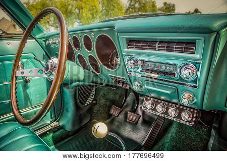 Car of the sixties AM radio with push buttons and hand cranks for the window!