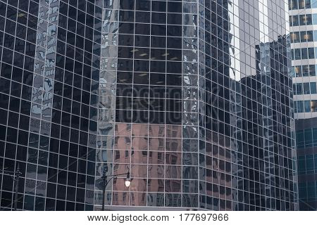 Close up majestic multi-storey buildings mirroring constructions in Chicago. Reflection concept