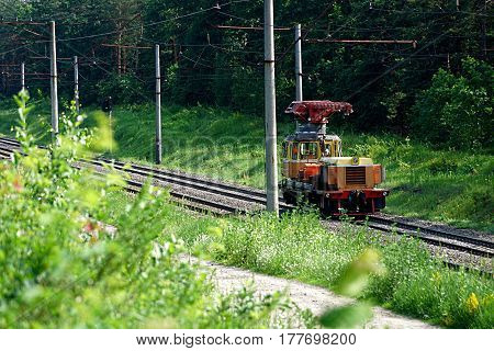 Repair train on the railway in nature