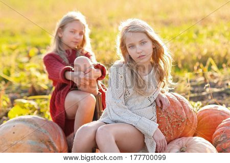Portrait Of Two Sisters During The Autumn Harvest