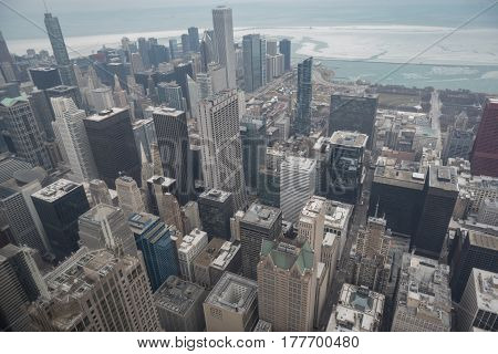 Top view of beautiful large high-rising blocks stretching roofs to sky. Chicago city surrounding by cold water