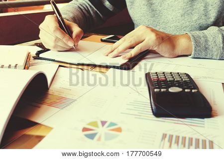 Businesswoman Writing Make Note And Calculate About Debt At Home Office.