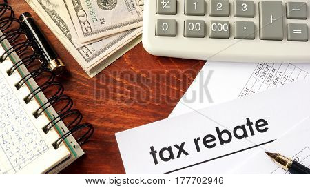 Document with title tax rebate on a table.