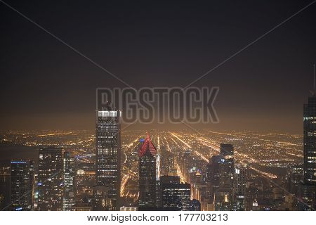Top view of city night Illinois, United States. Endless multistorey houses growing in distance
