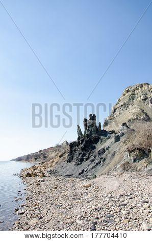 vanishing cliffs of ancient rocks on the shore
