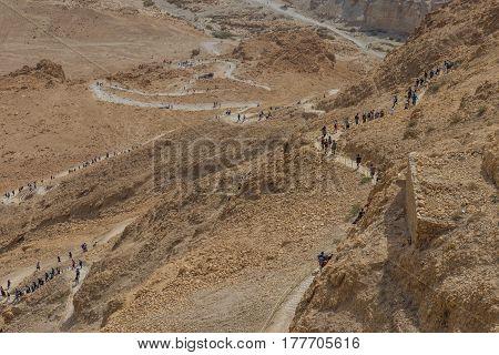 Masada, Israel - February 27, 2017: Hikers At The Snake Path In Masada Fortress At Sunny Day.