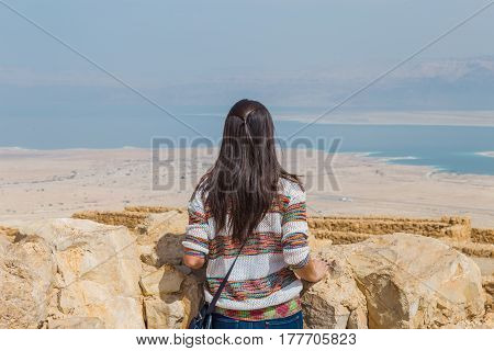 Girl Looking The Dead Sea From The Ruins Of The Ancient Masada Fortress In The Judaean Desert, Israe