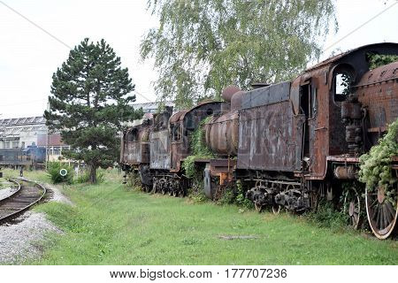 abandoned vintage locomotive vehicles in the last century ingrown weeds
