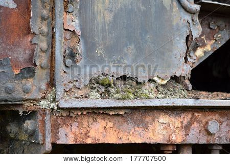 part of the old rusty vintage locomotives that ran on coal
