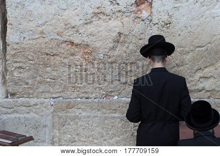 Jew praying at the Western Wall in Jerusalem