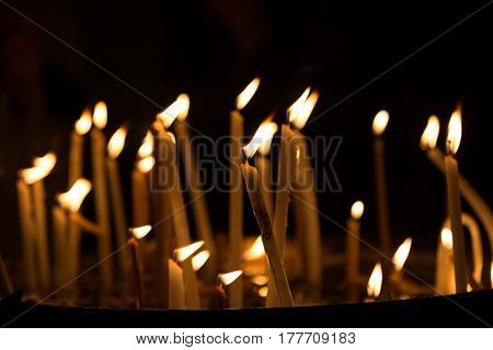 Candles Light. Candles Burning At Night. Abstract Candles Background. Golden Light Of Candle Flame.