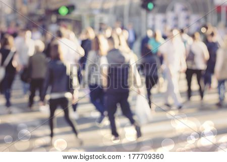 pedestrian on zebra in motion blur Blur abstract people background unrecognizable silhouettes of people walking on a street