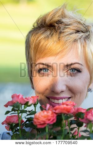 Real Woman Smelling Flowers Outdoors