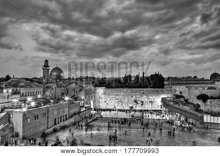The Temple Mount - Western Wall and the golden Dome of the Rock in the old city of Jerusalem Israel. Black and white HDR image.