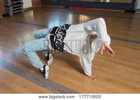 Young man break dancing hip-hop in gym classroom