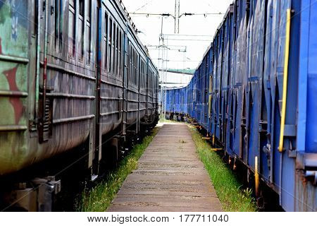 old blue freight wagons on the railway