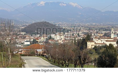 panorama of a small town in northern Italy with a backdrop of mountains