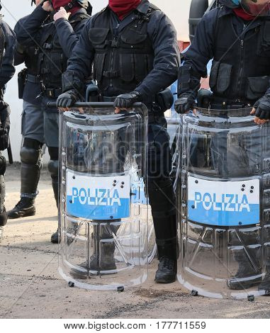 Italian Police Officers In Riot Gear With The Word Polizia Meani