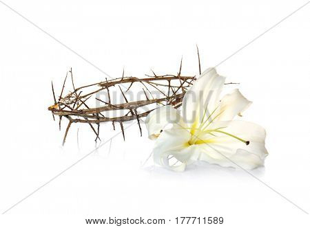 Crown of thorns and Easter white lily on white background