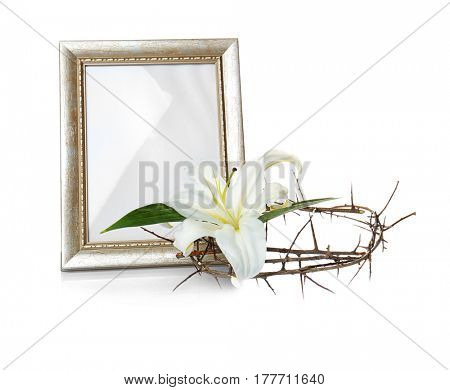 Frame, crown of thorns and Easter white lily on white background