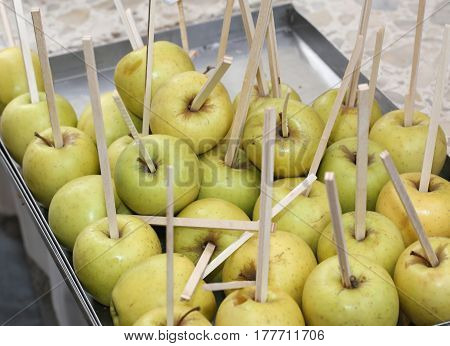 Apples Stuffed With Wooden Sticks Ready To Be Cooked With Carame