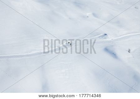 Top view picture of two skiers running on the snowcapped mountains