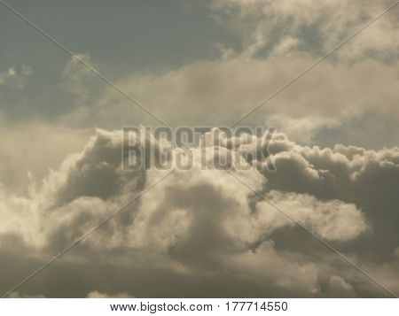 Dramatic shadowy cumulus clouds in sky over San Jose,California