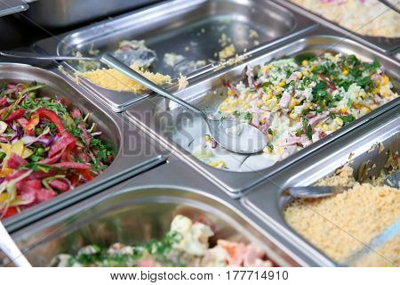 Steel self service trays filled with delicious food