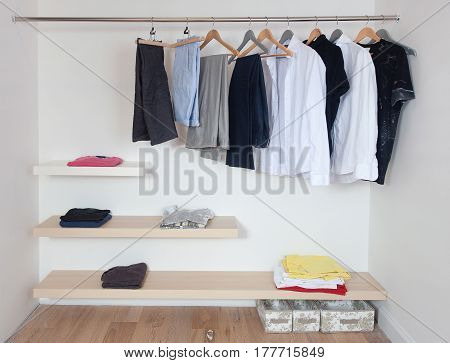 Open wardrobe with a various clothes, modern design