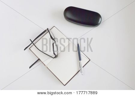 pen, glasses and notepad for writing text