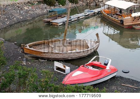 TIBERIAS ISRAEL - FEBRUARY 27 2017: Old and new boats on the shore of the Kinneret