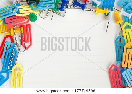 Multicolored paper clips isolated on white background with copy space for text