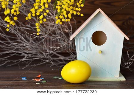 Easter card with Easter egg birdhouse and spring flowers