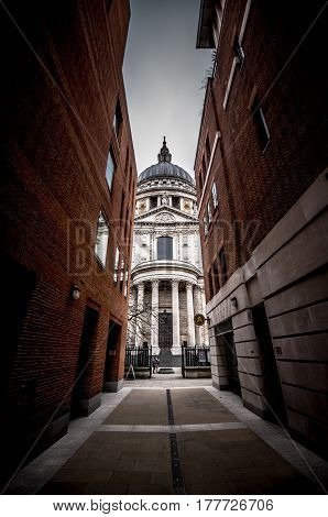 The prospect of the Cathedral of Saint Paul through a narrow alley that faces the rear of the main facade